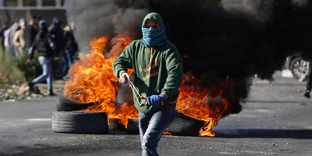Palestinian protester in Ramalla. Photo: AFP