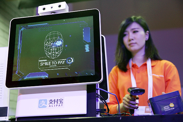 A facial recognition payment station by Alipay. Photo: AFP