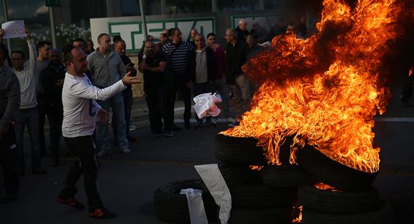 הפגנות בעקבות פיטורים ב טבע ירושלים מחאה פיטורי עובדים ב טבע, צילום: אוהד צויגנברג