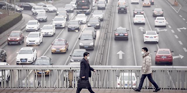 כלי רכב בסין שמזהמים את האוויר, צילום: בלומברג