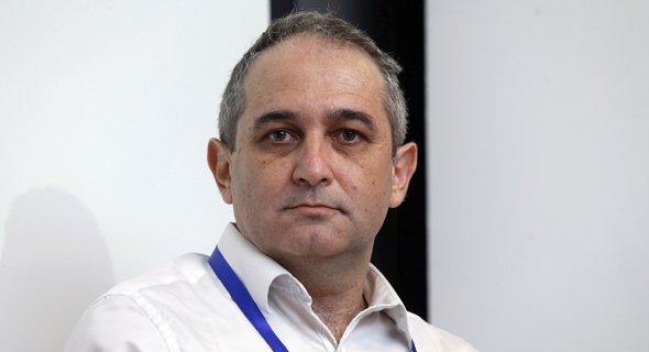 אסף שוהם מנהל ההשקעות הראשי מגדל, צילום: עמית שעל