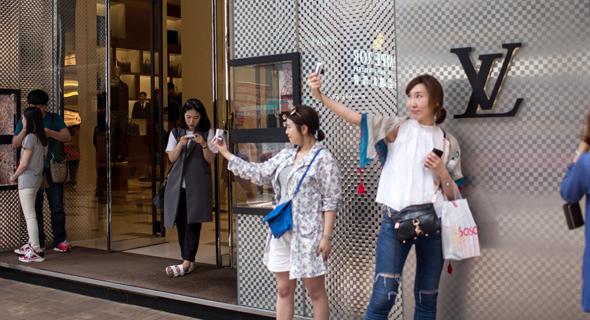 חנות של לואי ויטון בהונג קונג , צילום: בלומברג
