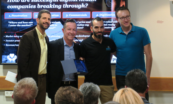 Left to right: mHealth Israel founder Levy Shapiro, Henry Ford Innovation Institute CEO Scott Dulchavsky, Montfort CEO Ziv Yekutieli, Montfort CTO Dima Gershman. Photo: Ben Hajaj
