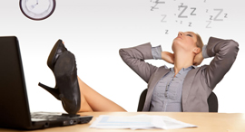 An executive sleeping at her desk. Photo: Shutterstock