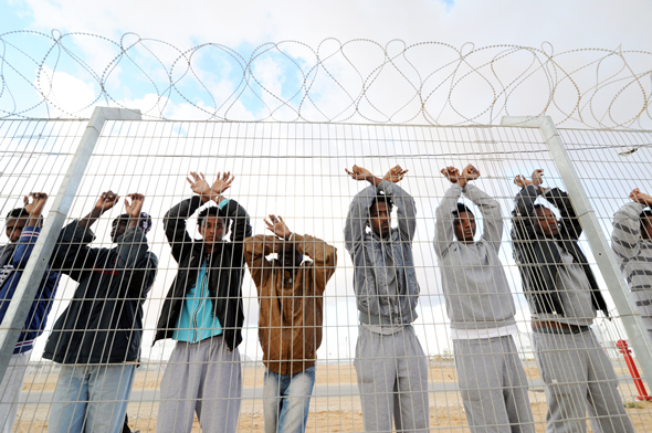 Refugees protesting deportation at a detention camp in Israel