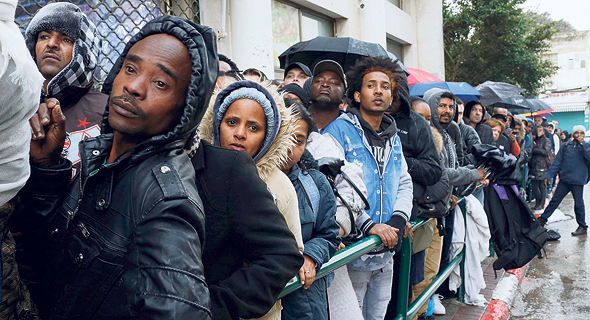 A line of asylum seekers formed outside a government office in Tel Aviv. Photo: Amit Shaal
