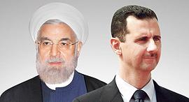 מימין נשיא סוריה בשאר אל אסד ונשיא איראן חסן רוחאני, צילום: איי פי, בלומברג