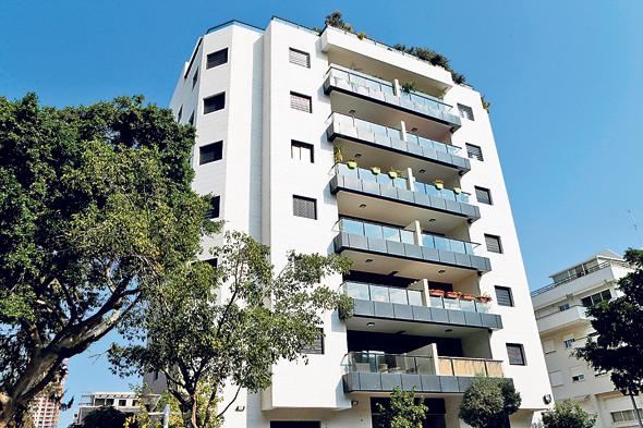 בניין במרכז הארץ. חלום רכישת הדירה עובר דרך שמאי של הבנק