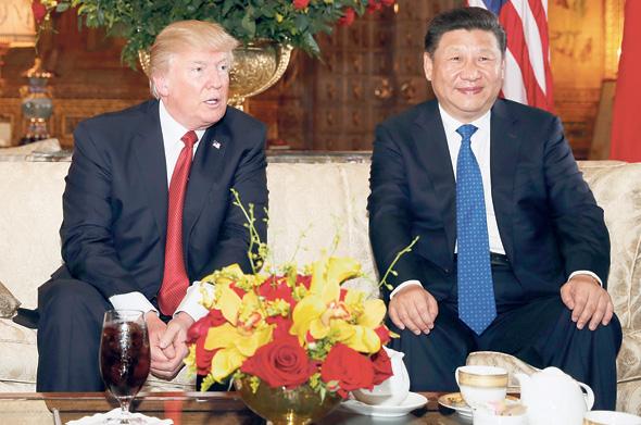 """נשיא סין שי ג'ינפינג ונשיא ארה""""ב דונלד טראמפ, צילום: איי פי"""
