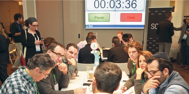 Investors meeting with entrepreneurs at Meet & Pitch. Photo: Orel Cohen