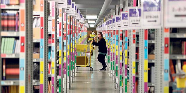 מחסן לוגיסטי של אמזון בגרמניה. הניהול הממוכן ממחיש עד כמה מדובר במעצמה טכנולוגית, צילום: אי פי איי