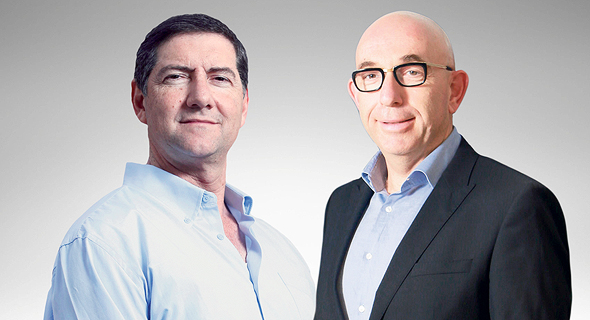 """מימין: מנכ""""ל עמידר ראובן קפלן ויו""""ר הדירקטוריון היוצא יצחק לקס. """"לא מתערב במינויים"""""""
