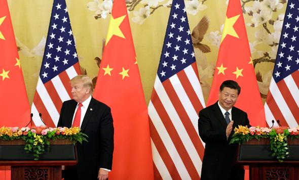"""נשיא סין שי ג'ינפינג ונשיא ארה""""ב דונלד טראמפ"""