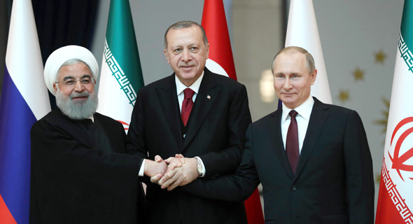 Iranian President Rouhani, Turkish President Erdoğan, and Russian President Putin. Photo: AFP