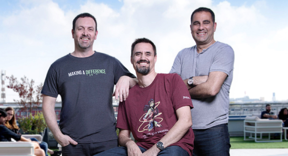 JFrog's co-founders Yoav Landman (left),  Frederic Simon (middle), and Shlomi Ben Haim (right). Photo:: Shachar Maor