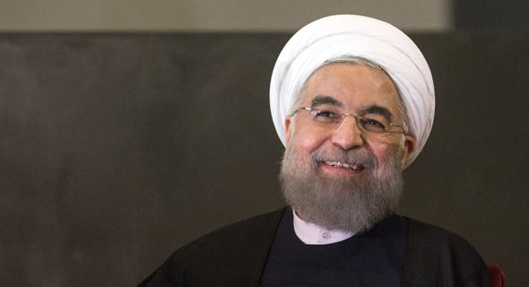 הנשיא חסן רוחאני. ימשיך לחייך?, צילום: בלומברג