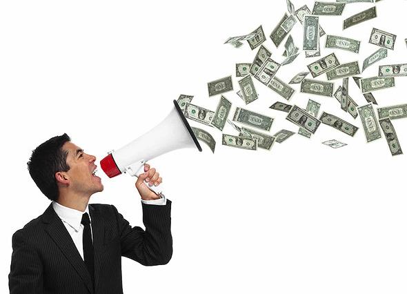 Money megaphone. Photo: Shutterstock