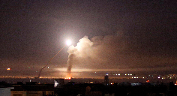 An anti-aircraft system firing at Israeli jets in Syria overnight. Photo: Reuters