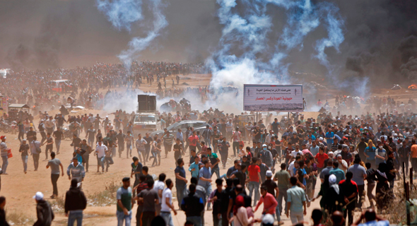 Clashes between Paletinian protesters and Israeli forces. Photo: AFP