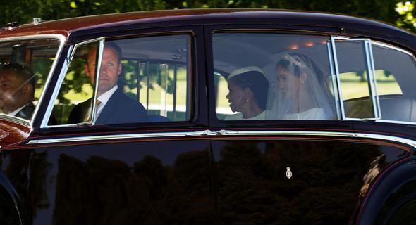 מייגן מרקל ברכב המלכותי בדרכה לטקס חתונתה, צילום: רויטרס