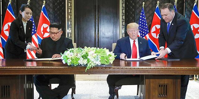 טראמפ וקים חותמים על הסכם, צילום: איי פי