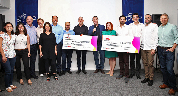 The winners receiving the award on Monday in Jerusalem. Photo: Orel Cohen