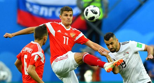 רוסיה נגד מצרים במונדיאל. הבטיחו את מקומם בשמינית הגמר , צילום: רויטרס