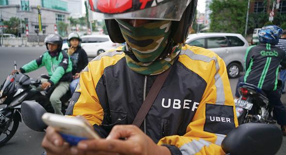 נהג של אובר ב אינדונזיה, צילום: בלומברג