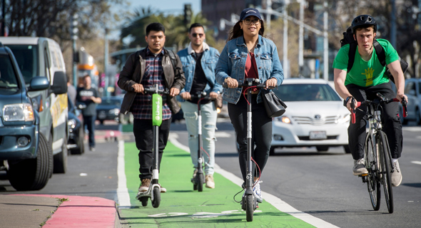 People riding electric scooters in San Francisco. Photo: Bloomberg