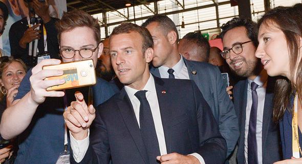 נשיא צרפת עמנואל מקרון בכנס טכנולוגיה בפריז, צילום: אם סי טי