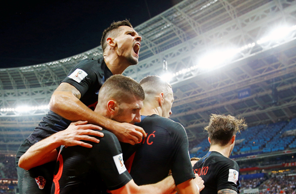שחקני קרואטיה חוגגים נגד בלגיה
