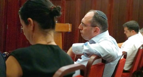 """מוטי בן משה ב אסיפת מחזיקי אג""""ח של אפריקה ישראל"""