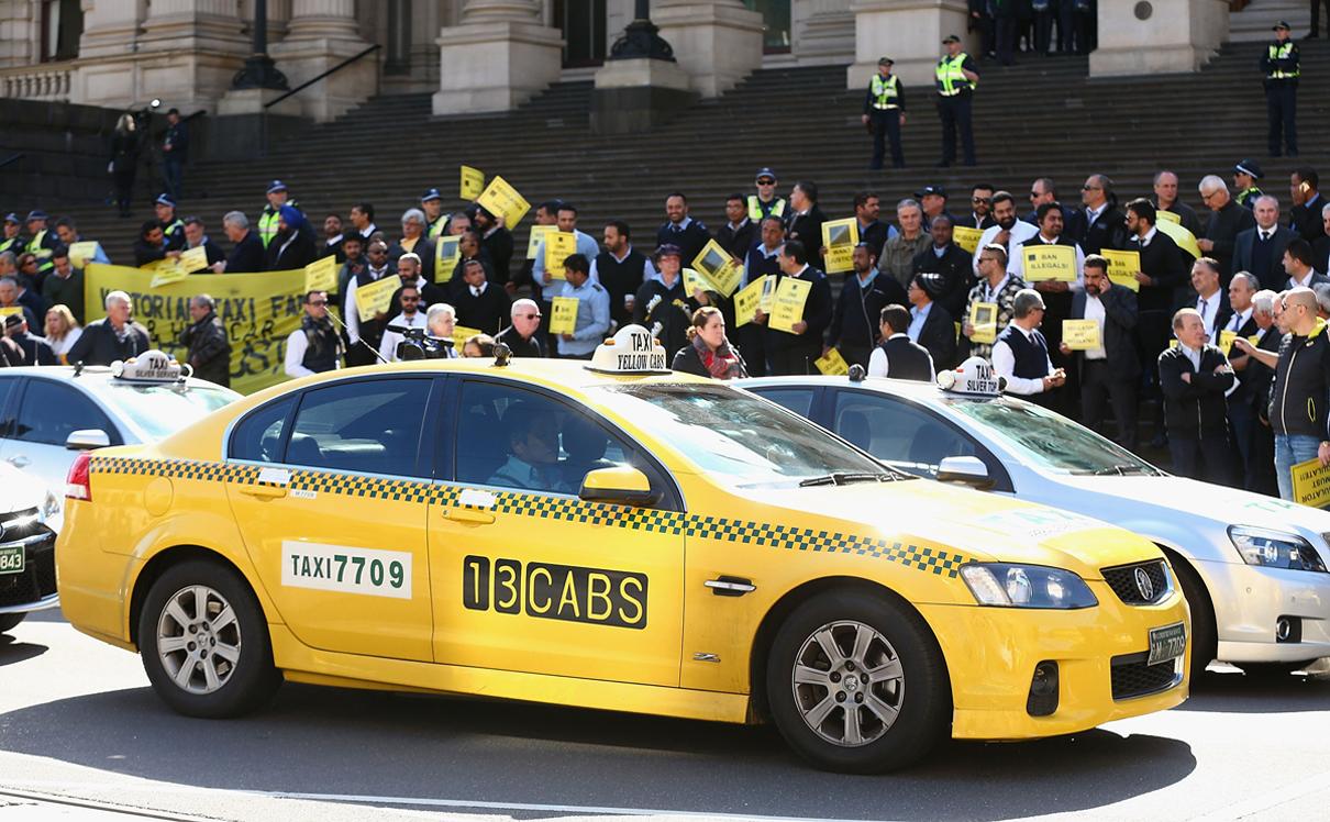 מוסף שבועי 19.7.18 מחאה של נהגי מוניות נגד אובר במלבורן אוסטרליה, צילום: גטי אימג'ס