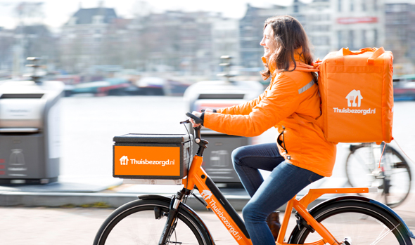 A Takeaway.com delivery woman in the Netherlands. Photo: PR