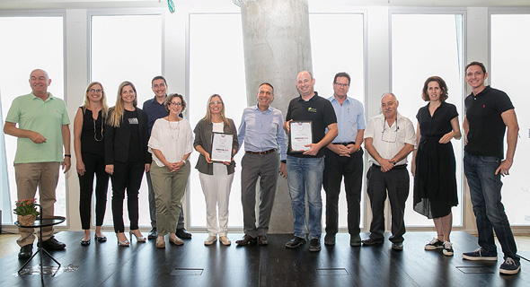 The judges and winners of the Calcalist's FoodTech competition. Photo: Orel Cohen