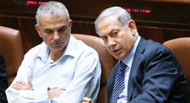 Netanyahu and Lapid. Photo: Alex Kolomoisky