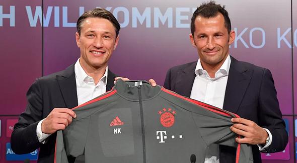 מימין: חסן סליהמיצ'יץ', המנהל הספורטיבי של באיירן מינכן וניקו קובאץ'. פשרה שאף אחד לא ממש אוהב