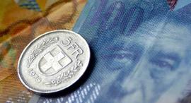 פרנק שוויצרי כסף מטבעות שטרות שוויץ, צילום: בלומברג