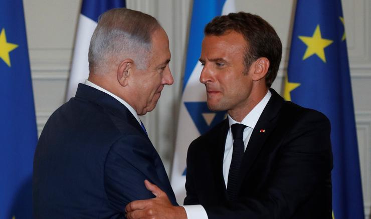 """נתניהו עם נשיא צרפת עמנואל מקרון בפריז, ביוני. """"מנהיגים באירופה הפסיקו להאמין בנתניהו. גם אני"""""""