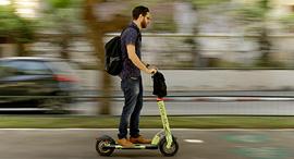 An e-scooter user in Tel Aviv. Photo: Amit Sha'al
