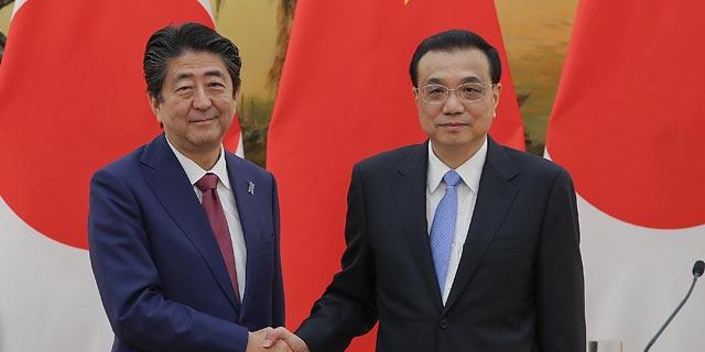 ותודה לטראמפ: יפן וסין מחממות את הקשרים הכלכליים