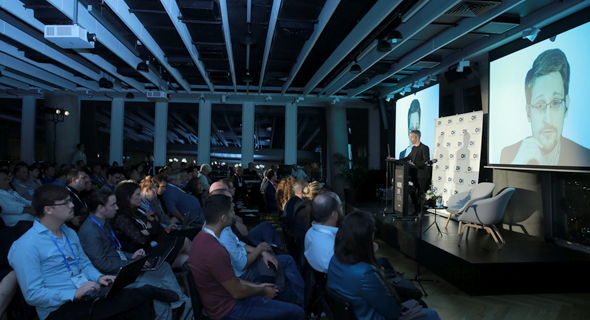 Edward Snowden speaking via video at an event in Tel Aviv. Photo: Orel Cohen