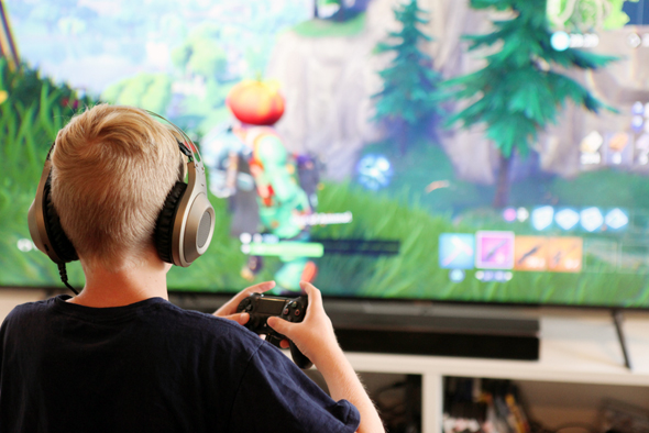 A child playing a video game. Photo:Shutterstock