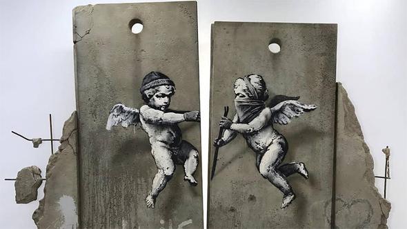 רפליקה של חומת ההפרדה בגדה שמוצגת ביריד תיירות בלונדון, צילום: banksy.co.uk