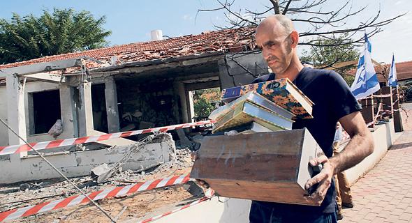 בית באשקלון שנפגע מרקטה, צילום: AFP