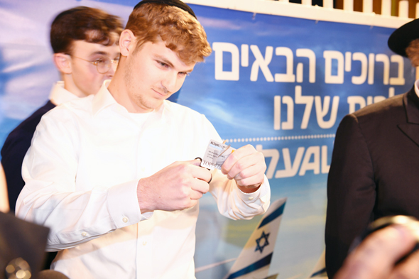 Ultra-Orthodox El Al customers cut frequent flier cards in protest. Photo: Yair Sagi