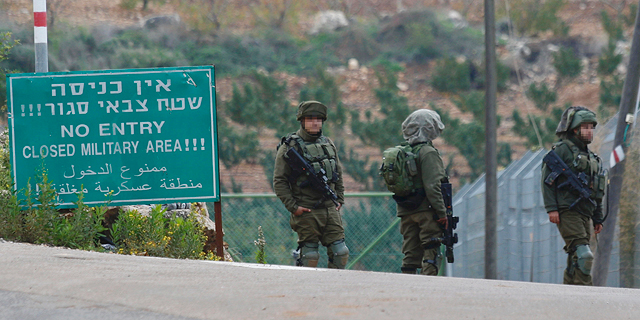 Israeli troops on the Lebanon-Israel border. Photo: AP