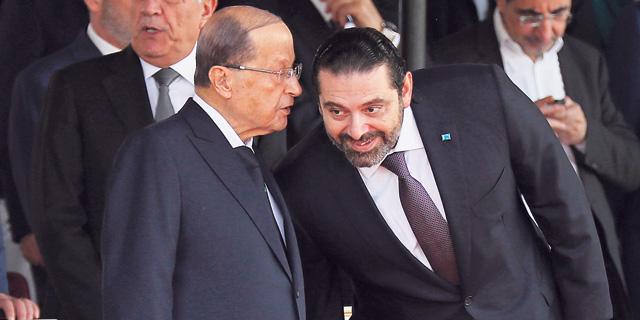 ראש ממשלת לבנון סעד אלחרירי (מימין) והנשיא מישל עאון. חיזבאללה ירצה לקבל גם תיקים חברתיים בממשלה החדשה, צילום: AP