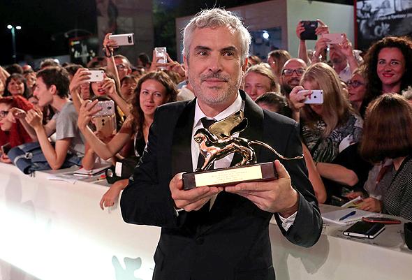 הבמאי אלפונסו קוארון בפסטיבל ונציה, צילום: רויטרס