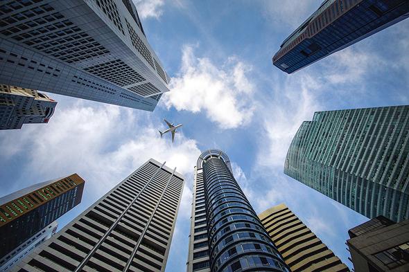 מגדלי משרדים בסינגפור. עד 2030 יפעלו 30% מהמשרדים במודל השיתופי